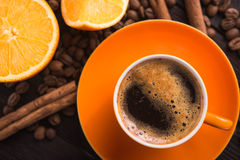 Coffee cup with orange fruit Stock Images