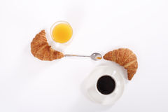 Coffee cup and orange juice with two croissants. Coffee and orange juice with two croissants Royalty Free Stock Photography