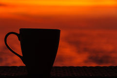 Coffee cup in the orange Royalty Free Stock Photos