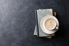 Coffee cup over books. On stone table. Top view with space for your text Stock Images