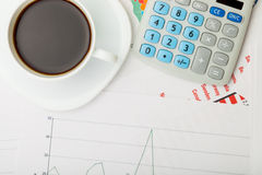 Coffee cup over financial documents Stock Photography