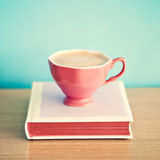 Coffee cup over hardcover book Royalty Free Stock Photo