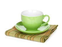 Coffee cup over kitchen towel Royalty Free Stock Photos