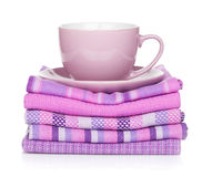 Coffee cup over kitchen towels Royalty Free Stock Images