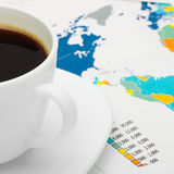 Coffee cup over map - close up shot Stock Photography