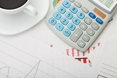 Coffee cup over some financial documents - view from top Royalty Free Stock Photography