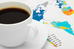Coffee cup over world map - business concept Stock Photo