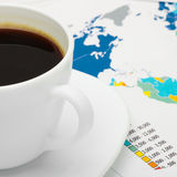 Coffee cup over world map - close up Stock Photography