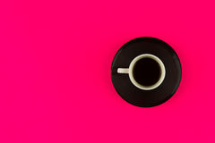 Coffee cup overhead on bright pink background. Minimalist shot of coffee cup on bright background stock photography