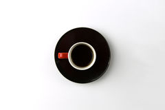 Coffee cup overhead on white background. Minimalist shot of coffee cup on bright background Stock Photography