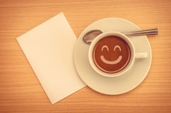 Coffee cup with paper note on table Stock Photos