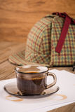 Coffee cup, paper sheets and detective hat Royalty Free Stock Photos