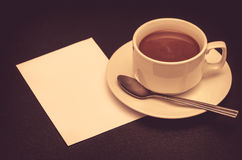 Coffee cup and papernote on table Stock Photo
