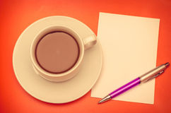 Coffee cup and papernote on table Stock Photos