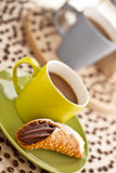 Coffee cup with pastry Stock Photos