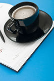 Coffee cup pen and agenda Royalty Free Stock Image
