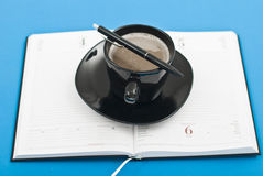 Coffee cup pen and agenda Stock Photo