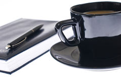 Coffee cup pen and agenda Stock Photos