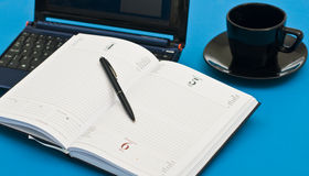 Coffee cup, pen, agenda and notebook Stock Photo