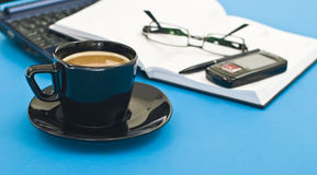 Coffee cup, pen, agenda and notebook. Coffee cup, pen, agenda, pair of glasses, phone and  notebook, scheduling the day, taking a break Stock Photography
