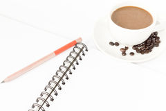 Coffee cup and pencil note isolated on white background. royalty free stock images