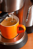 Coffee cup in the percolator Royalty Free Stock Photo