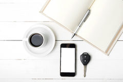 Coffee cup with phone,car key and open notebook Stock Image