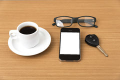 Coffee cup and phone with car key Stock Images