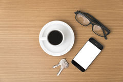 Coffee cup and phone with key Royalty Free Stock Photos