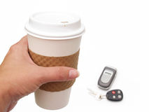 Coffee cup, phone and keys Stock Photos