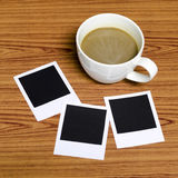 Coffee cup with photo frame Royalty Free Stock Images