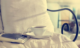 Coffee cup and pie in the morning on the bed background Royalty Free Stock Image