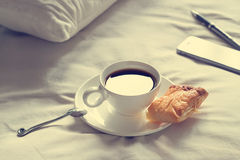 Coffee cup and pie in the morning on the bed background Stock Photos