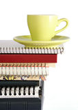 Coffee Cup on Pile of Notebook Royalty Free Stock Photos