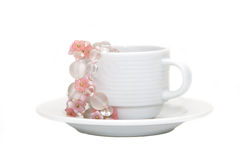 Coffee cup with pink flower decoration Stock Image