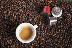 Coffee cup with pods Royalty Free Stock Photography