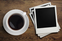 Coffee cup and polaroid photo frames on table stock photos