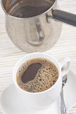 Coffee cup and pot. Coffee brewed in a pot and full cup Stock Images