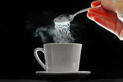 Coffee cup and pouring sugar spoon Royalty Free Stock Photography