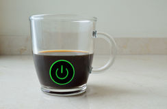Coffee in a cup with a power button Stock Photo