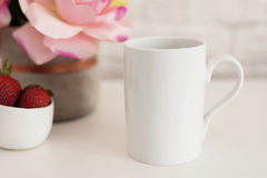 Coffee Cup Product Display. Coffee White Table. Strawberries In Gold Bowl, Vase With Pink Roses Stock Photography