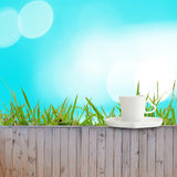Coffee cup put on fence as turquoise background texture Stock Photos