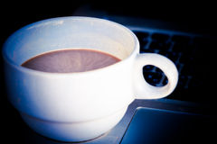 Coffee cup put on laptop Royalty Free Stock Photos