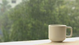 Coffee cup on a rainy day Stock Images