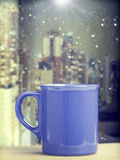 Coffee cup on a rainy day in front of the window Royalty Free Stock Photos