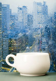 Coffee cup on a rainy day in front of the window Stock Images