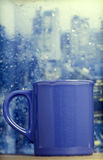 Coffee cup on a rainy day in front of the window Stock Photography