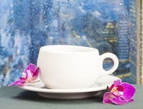 Coffee cup on a rainy day on window background Stock Image