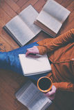 With coffee cup after reading books stock photos