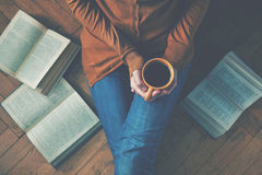 Coffee cup after reading books. Girl having a break with cup of fresh coffee after reading books or studying Stock Images